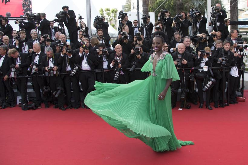 "[12:50] Actress Lupita Nyong'o poses on the red carpet as she arrives for the opening ceremony and the screening of the film ""La tete haute"" out of competition during the 68th Cannes Film Festival"