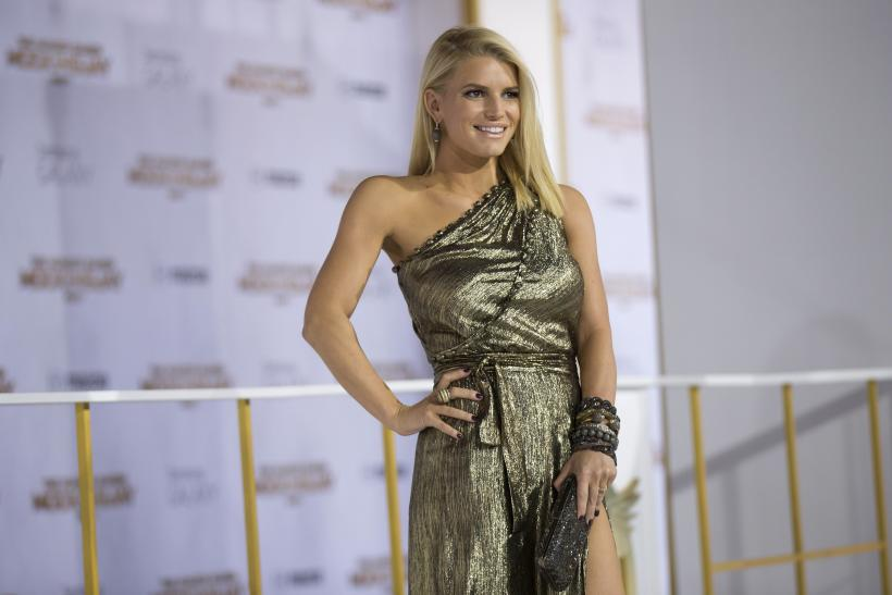 "[12:43] Actress Jessica Simpson poses at the premiere of ""The Hunger Games: Mockingjay - Part 1"" in Los Angeles"