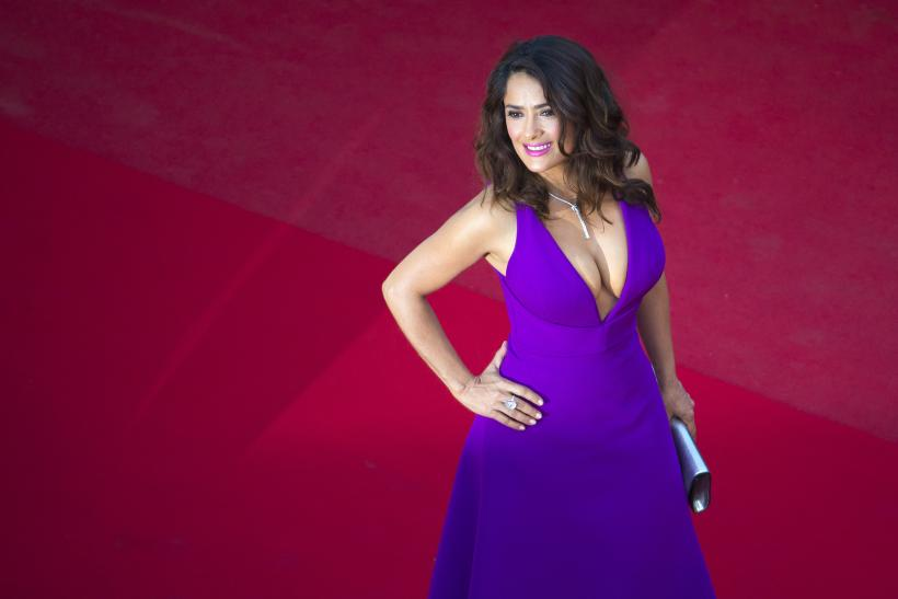 """[8:26] Actress Salma Hayek poses on the red carpet as she arrives for the screening of the film """"Carol"""" in competition at the 68th Cannes Film Festival"""