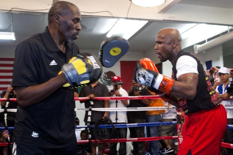 Roger Mayweather with Floyd Mayweather Jr.