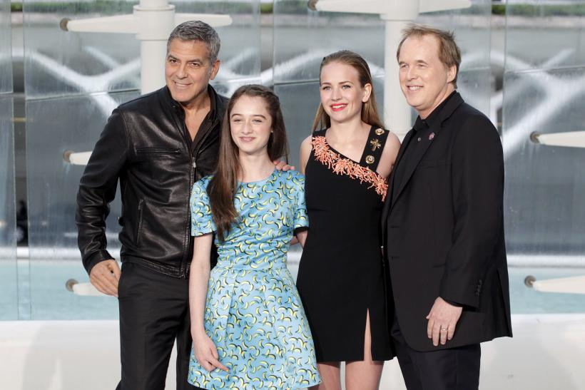 """[9:19] (L-R) Cast members George Clooney, Raffey Cassidy, Britt Robertson and director Brad Bird pose at the City Of Arts and Sciences before the premiere of the movie """"Tomorrowland"""" in Valencia"""