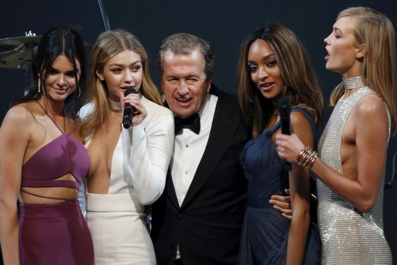 [11:13] U.S. model Kendall Jenner, U.S. model Gigi Hadid, Peruvian photographer Mario Testino, British model Jourdan Dunn and U.S. model Karlie Kloss (L to R) conduct an auction during the amfAR's Cinema Against AIDS 2015