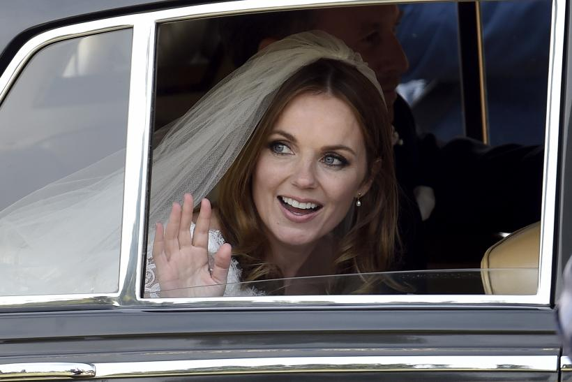 [8:46] British singer and former member of the band Spice Girls, Geri Halliwell, leaves with her husband, Christian Horner, Red Bull Formula One team principal, following their wedding at St. Mary's Church at Woburn