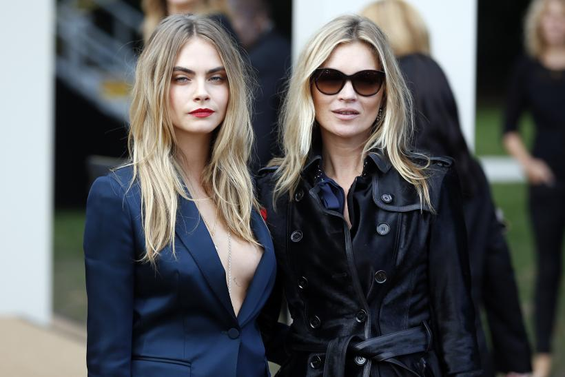 [8:44] Models Cara Delevingne (L) and Kate Moss arrive to attend the presentation of the Burberry Spring/Summer 2015 collection