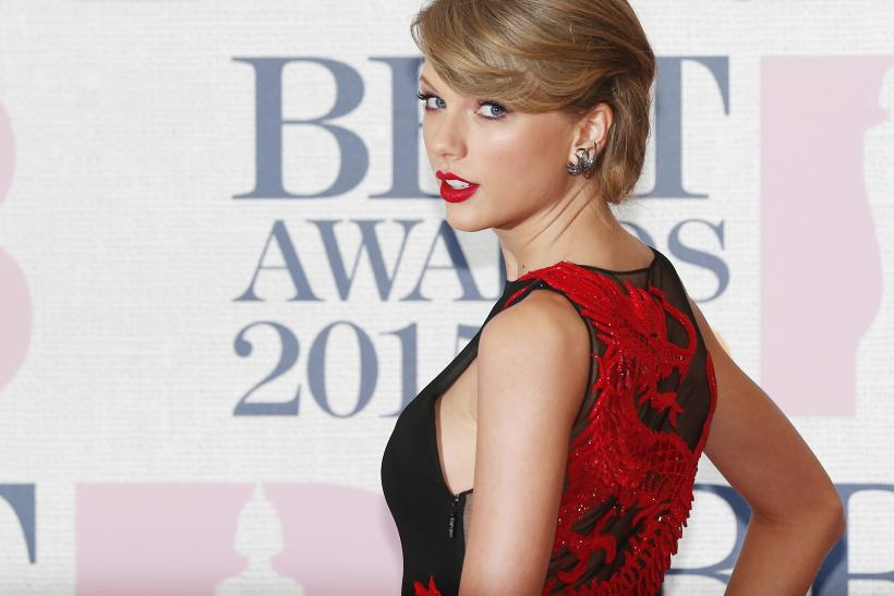 [8:20] Singer Taylor Swift arrives for the BRIT music awards at the O2 Arena in Greenwich, London