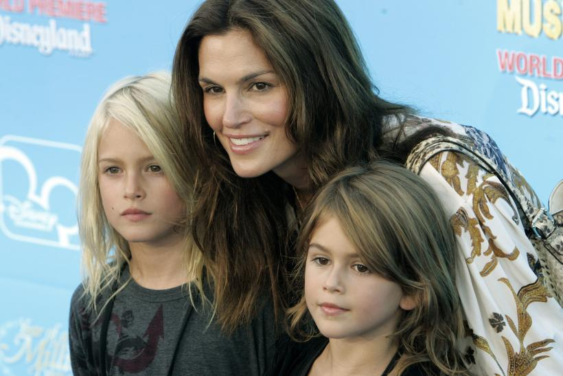 "[8:03] Model Cindy Crawford poses with her children son Presley (L) and daughter Kaya at the premiere of the Disney Channel movie ""High School Musical 2"""