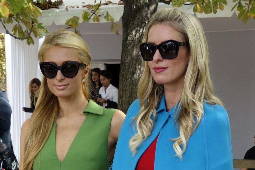 [8:24] Socialites Paris (L) and Nicky Hilton pose after the Valentino Spring/Summer 2015 women's ready-to-wear collection show