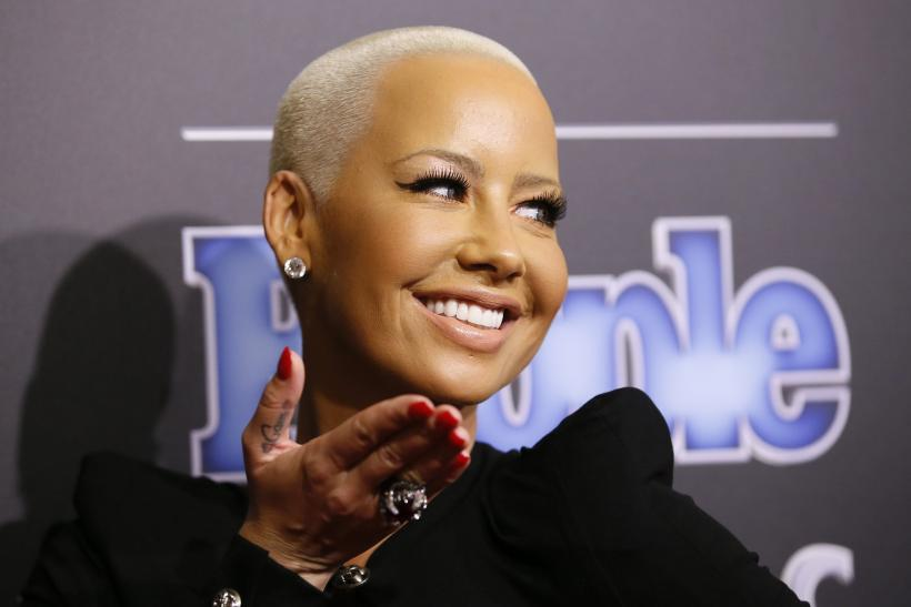 [9:11] Amber Rose arrives at the People Magazine Awards in Beverly Hills