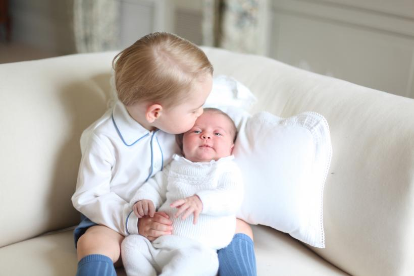 [8:03] Prince George and Princess Charlotte are seen in this undated handout photo taken by the Duchess in mid-May at Anmer Hall in Norfolk
