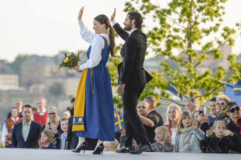 [8:18] Prince Carl Philip and his fiancee Sofia Hellqvist wave during the Sweden National Day celebrations in Stockholm
