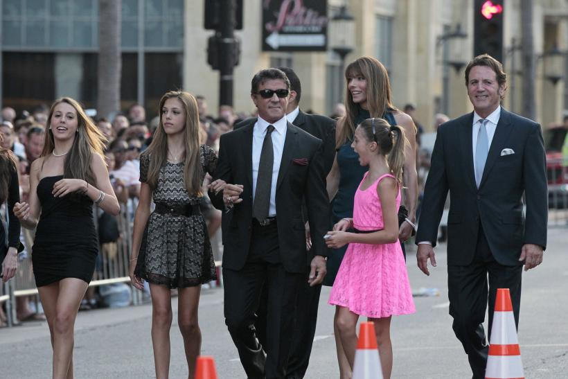 "[9:03] Cast member Sylvester Stallone arrives with his wife Jennifer Flavin and their daughters Sophia (L), Sistine (2nd L), Scarlet and his brother Frank (R) at the premiere of ""The Expendables 2"""