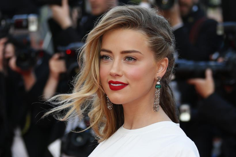 "[11:00] Amber Heard poses on the red carpet as she arrives for the screening of the film ""Deux jours, une nuit"" (Two Days, One Night) in competition at the 67th Cannes Film Festival"
