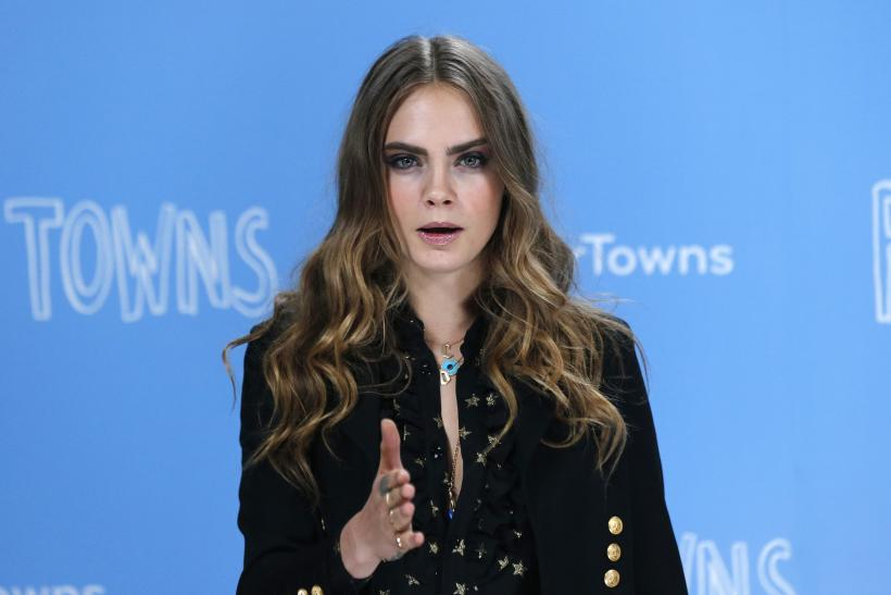 [11:23] Cast member Cara Delevingne poses for photos at a photo call promoting her film 'Paper Towns' at Claridges in London
