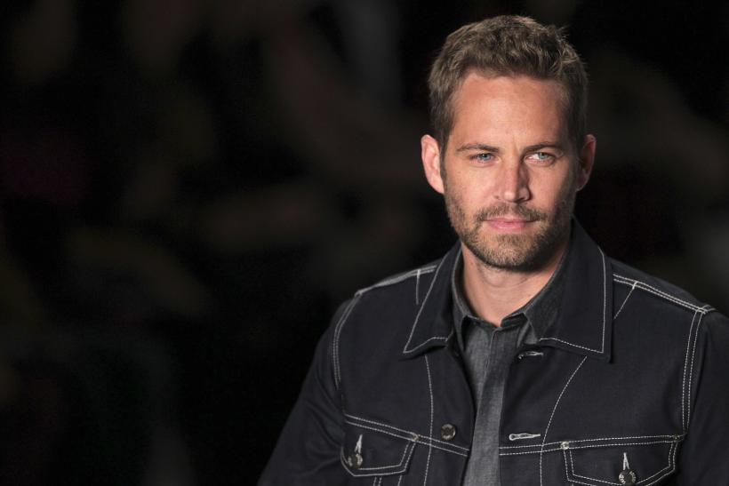 [12:21] U.S. actor Paul Walker presents a creation from Colcci's 2013/2014 summer collection during Sao Paulo Fashion Week