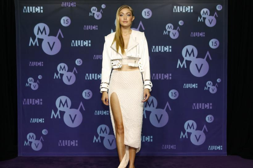 [10:27] American model Gigi Hadid poses backstage at the MuchMusic Video Awards (MMVAs) in Toronto