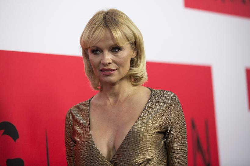 "[11:34] Actress Pamela Anderson poses at the premiere of ""The Gunman"" in Los Angeles, California"
