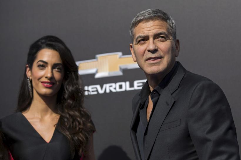 """[01:26] Cast member George Clooney and his wife Amal pose at the premiere of """"Tomorrowland"""" at AMC theatres in Downtown Disney in Anaheim"""