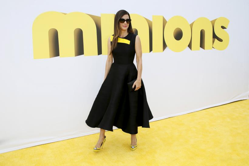 "[10:08] Actress Sandra Bullock poses at the premiere of the film ""Minions,"" in Los Angeles"