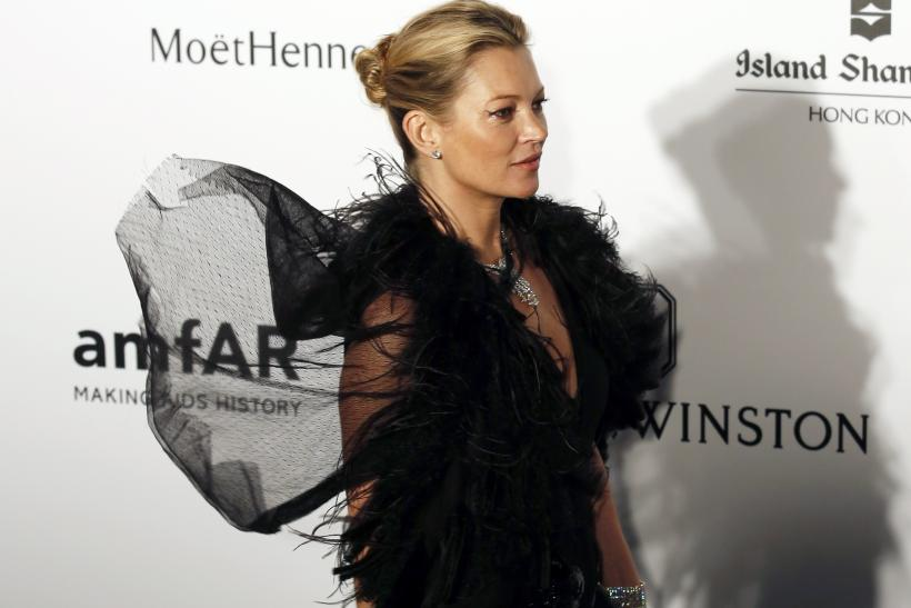 [8:38] British model Kate Moss poses upon arrival at the Foundation for AIDS Research's (amfAR) inaugural fundraising gala in Hong Kong