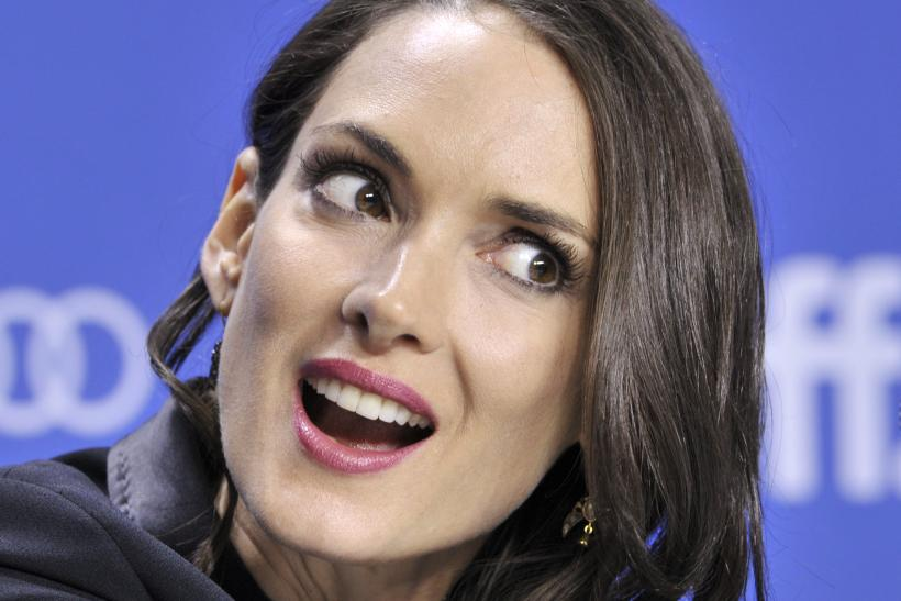 "[10:15] Actor Winona Ryder reacts during a news conference for the film ""The Iceman"" at the 37th Toronto International Film Festival"