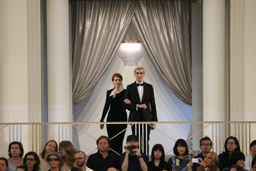[8:07] Actress Julianne Moore (L) presents a creation by German designer Karl Lagerfeld accompanied by Gabriel Day Lewis as part of his Haute Couture Fall Winter 2015/2016 fashion show for French fashion house Chanel
