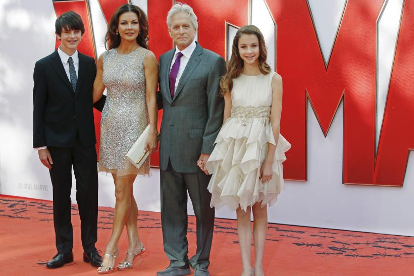 """[9:18] Husband and wife actors Catherine Zeta-Jones and Michael Douglas arrive with children Dylan and Carys for the European premiere of """"Ant-Man"""" at Leicester Square in London"""