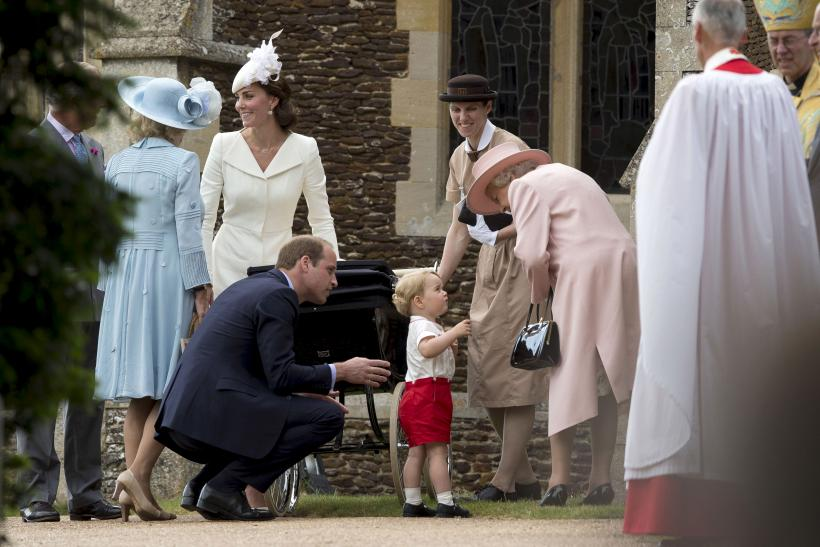 [13:21] Britain's Queen Elizabeth speaks to Prince George as they stand with Prince William, his wife Catherine, Duchess of Cambridge and Princess Charlotte after her christening at the Church of St. Mary Magdalene