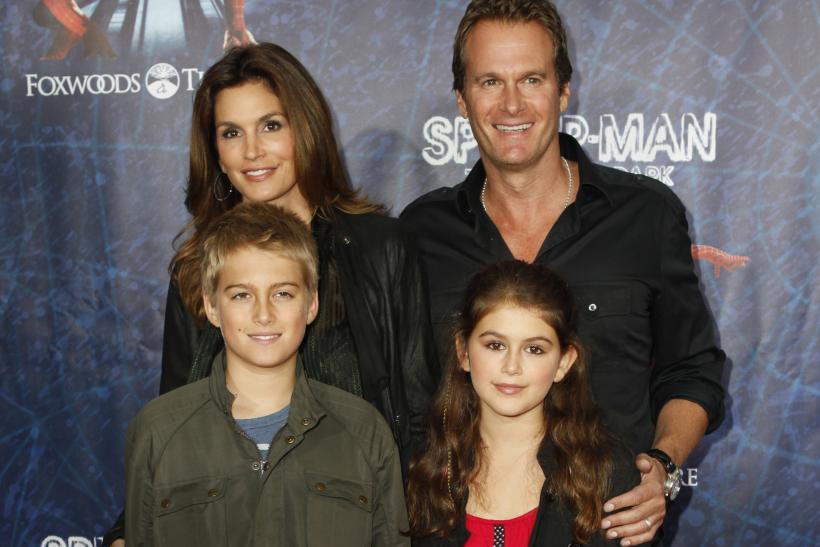 "[13:49] Model Cindy Crawford, her husband Rande Gerber, and their children, Presley Walker Gerber (front L) and Kaia Jordan Gerber, arrive at the Broadway opening of ""Spider-Man: Turn Off The Dark"" in New York"
