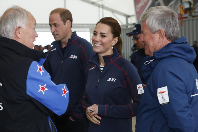 [12:15] Britain's Prince William and his wife Catherine, Duchess of Cambridge, speak with dignitaries as they tour the base of Emirates Team New Zealand