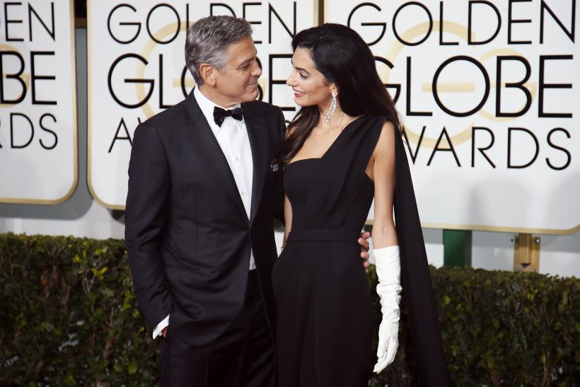 [9:55] Actor George Clooney and wife, Amal Clooney, arrive at the 72nd Golden Globe Awards