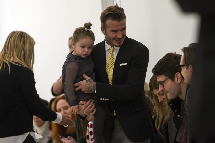 [08:34] Former England soccer captain David Beckham holds his daughter Harper before the Victoria Beckham Fall 2014 collection