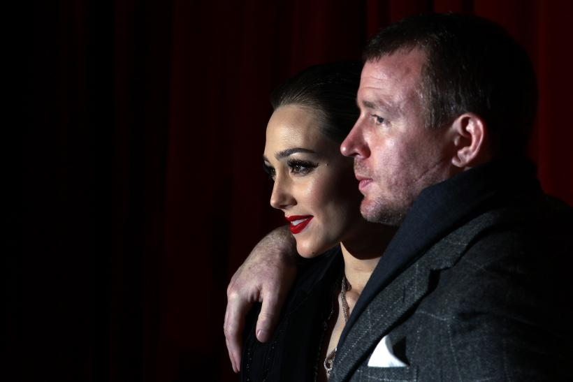 [11:45] British director Guy Ritchie (R) and his girlfriend British actress Jacqui Ainsley