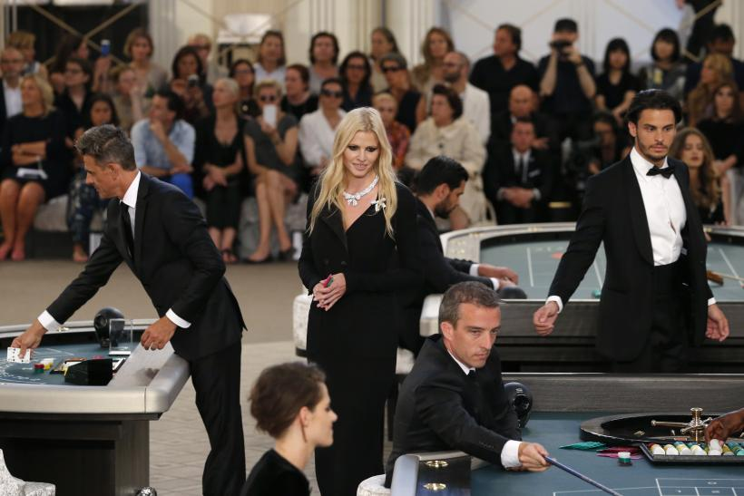 [12:12] Model Lara Stone presents a creation by German designer Karl Lagerfeld as part of his Haute Couture Fall Winter 2015/2016