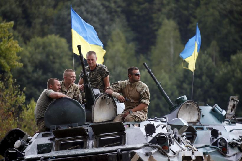 Ukrainian troops in a tank during training drills.