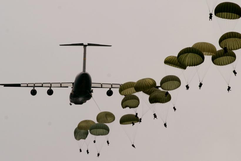 Army Rangers jump from a C-5 transport plane