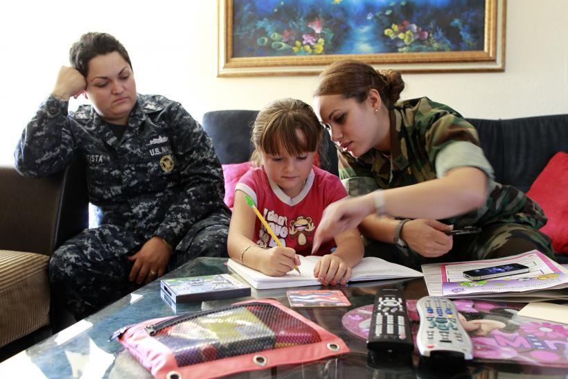 U.S. military same-sex couple with their child.