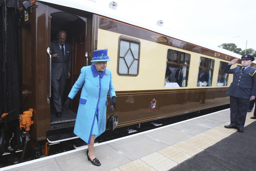 [12:33] Britain's Queen Elizabeth steps off the royal train at Newtongrange railway station