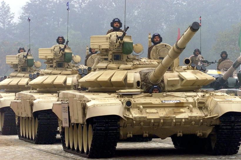 Indian soldiers driving the T-90MS tank