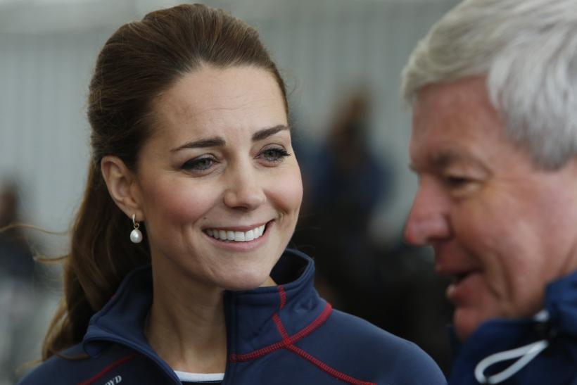 [08:46] Britain's Catherine, Duchess of Cambridge, smiles as she tours the base of Emirates Team New Zealand
