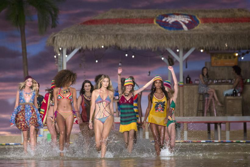 [11:51] Models walk through water at the conclusion of the Tommy Hilfiger Spring/Summer 2016 collection