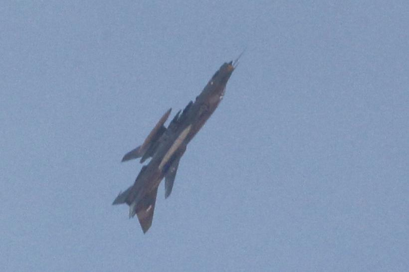 A Syrian jet maneuvering over the skies of Syria