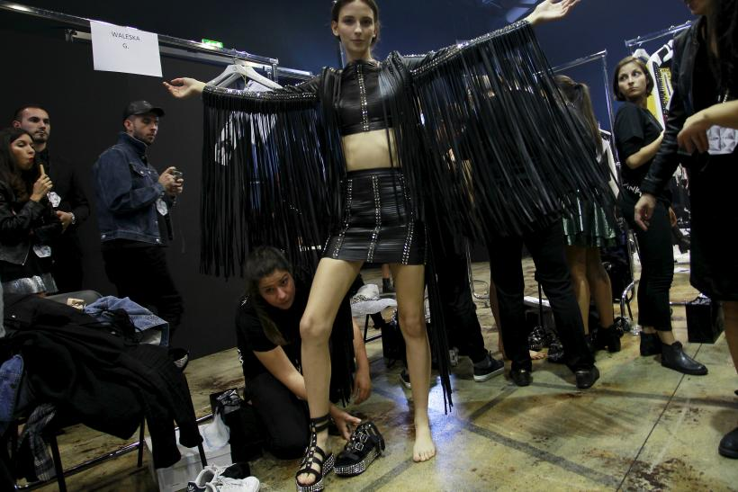 [13:29] A model backstage is pictured before the Philipp Plein Spring/Summer 2016