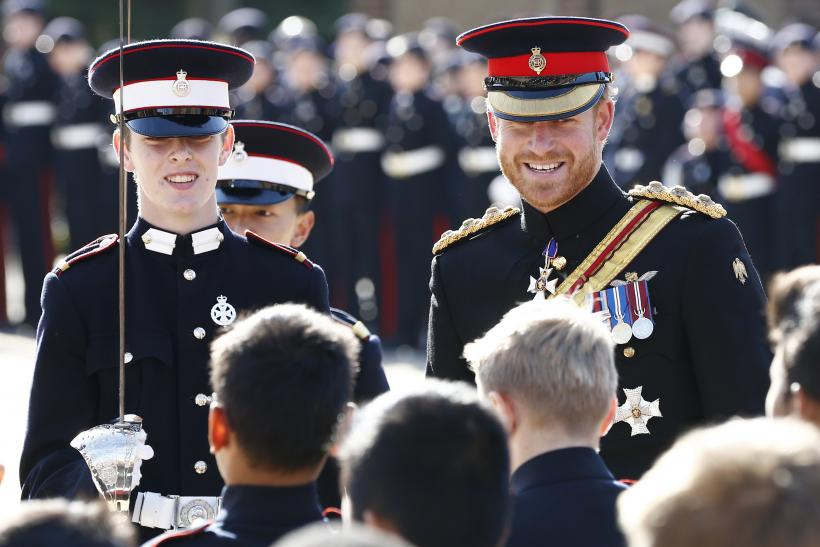 [12:26] Britain's Prince Harry inspects the student guards during his visit to The Duke of York's Royal Military School
