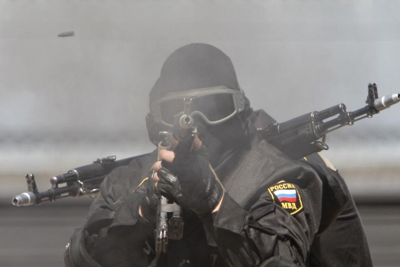 A Russian Special Forces soldier fires a rifle during a demonstration