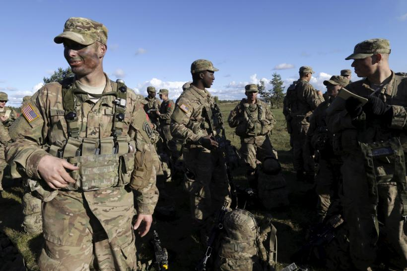 U.S. troops take a break from a training exercise in Europe