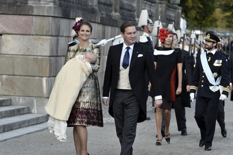 [09:47] Sweden's Prince Madeleine (L) holds her newly baptized son Prince Nicolas as she leaves the church with her husband Chris O'Neill