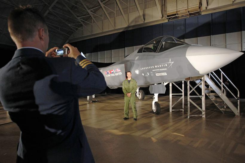 A Canadian service member next to an F-35.