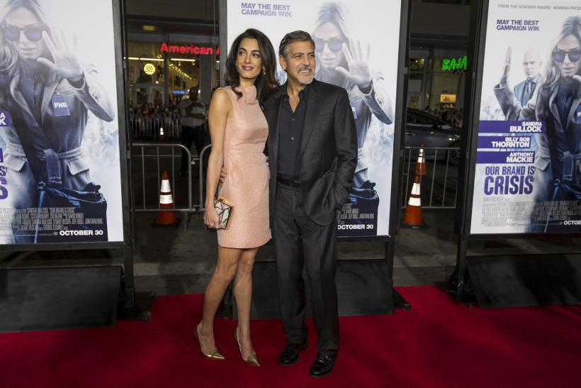 "[12:34] Producer George Clooney and his wife Amal pose at the premiere of ""Our Brand Is Crisis"" in Hollywood"