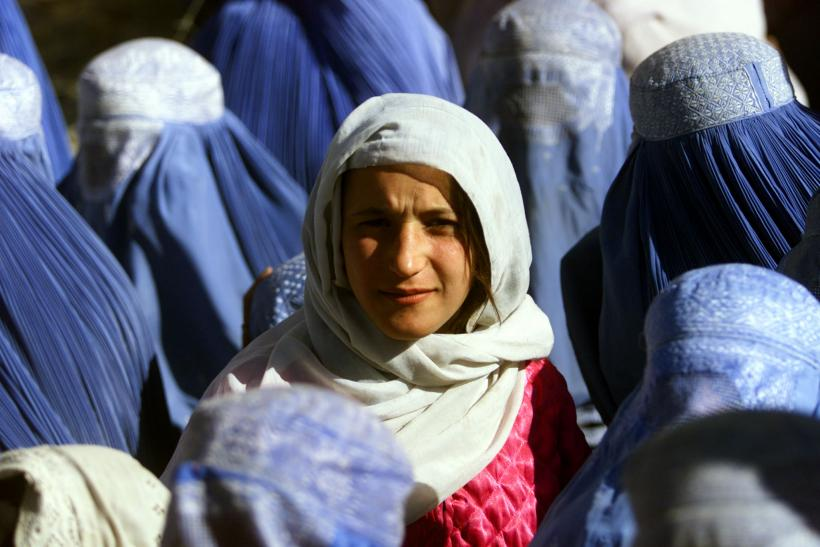 An Afghan woman reveals her face for the first time