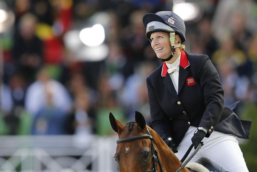 [07:51] Britain's Zara Phillips riding High Kingdom competes in the jumping test as part of the eventing competition